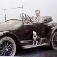 Photo - Dr. William Blake Gibb sits with his pit bull terrier, Jack, in this 1917 photo. Gibb, grandfather of dog trainer Molly Gibb, took Jack with him to visit patients at home. Molly Gibb of Arcadia trains pit bulls to work as therapy and search dogs. She is training one of the dogs rescued from the Michael Vick case.   Photo provided by Molly Gibb ORG XMIT: KOD