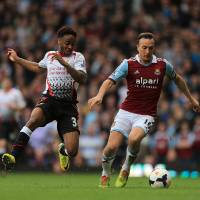 Photo - Liverpool's Raheem Sterling (left) and West Ham United's Mark Noble (right) battle for the ball during their English Premier League match at Upton Park, London,  Sunday April 6, 2014.   (AP Photo / Nick Potts,PA)  UNITED KINGDOM OUT  NO SALES  NO ARCHIVE