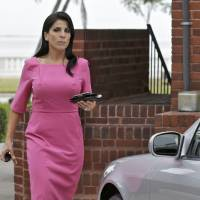 Photo -   Jill Kelley leaves her home Tuesday, Nov 13, 2012 in Tampa, Fla. Kelley is identified as the woman who allegedly received harassing emails from Gen. David Petraeus' paramour, Paula Broadwell. She serves as an unpaid social liaison to MacDill Air Force Base in Tampa, where the military's Central Command and Special Operations Command are located. (AP Photo/Chris O'Meara)