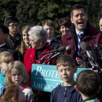 Photo - FILE - In this Dec. 12, 2012 file photo, Rep. Sean Duffy, R-Wis. right, accompanied by Rep. Virginia Foxx, R-N.N.C., center, and others, gestures as he speaks during a news conference on Capitol Hill in Washington. Duffy's office said in an email Thursday, Oct. 3, 2013, that the Republican was walking toward the Capitol to vote on legislation when someone he didn't know began screaming at him and grabbed his arm.The office said Duffy was not harmed but reported the incident to police as required by U.S. House security procedures. (AP Photo/Manuel Balce Ceneta, File)