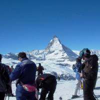 Photo -  Skiers and boarders in the Swiss village of Zermatt prepare for runs with the Matterhorn in the background. Photo courtesy of Athena Lucero.