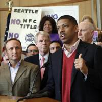 Photo - Sacramento Mayor Kevin Johnson speaks during a news conference to introduce the first part of his four-step plan to keep the Sacramento Kings NBA basketball team in Sacramento, Calif., on Tuesday, Jan. 22, 2013. Johnson, who said he has 19 local investors who have pledged at least $1 million each to buy the franchise, made his announcement a day after the Maloof family announced it has signed an agreement to sell the Kings to a Seattle group led by investor Chris Hansen. (AP Photo/Rich Pedroncelli)