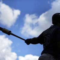 Photo -   Colorado Rockies' Wilin Rosario warms up before an at-bat in the first inning of the first game of a baseball doubleheader against the Philadelphia Phillies, Sunday, Sept. 9, 2012, in Philadelphia. (AP Photo/Matt Slocum)
