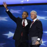 Photo -   President Barack Obama waves as he joins Former President Bill Clinton during the Democratic National Convention in Charlotte, N.C., on Wednesday, Sept. 5, 2012. (AP Photo/Charles Dharapak)