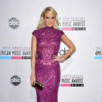 Photo -  Carrie Underwood walks the AMA red carpet.