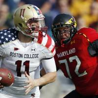 Photo -   Boston College quarterback Chase Rettig (11) looks to pass under pressure from Maryland defensive lineman Joe Vellano (72) in the second quarter of an NCAA college football game in Boston, Saturday, Oct. 27, 2012. (AP Photo/Michael Dwyer)