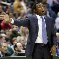 Photo - Brooklyn Nets head coach Avery Johnson reacts to a call during the first half of an NBA basketball game against the Milwaukee Bucks, Wednesday, Dec. 26, 2012, in Milwaukee. (AP Photo/Morry Gash)