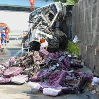 Photo -   The wreckage of a destroyed bus is left on a highway in Fujioka, Gunma prefecture, north of Tokyo Sunday, April 29, 2012. Police say the bus carrying dozens of holiday makers crashed on the highway while heading for Tokyo Disneyland, killing at least seven people and injuring dozens. (AP Photo/Kyodo News) JAPAN OUT, MANDATORY CREDIT, NO LICENSING IN CHINA, HONG KONG, JAPAN, SOUTH KOREA AND FRANCE