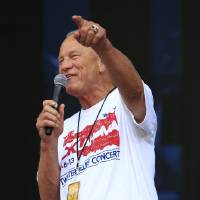 Photo - Barry Switzer opens the Oklahoma Twister Relief Concert at the Gaylord Family-Oklahoma Memorial Stadium on Saturday, July 6, 2013 in Norman, Okla. (Photo by Alonzo Adams/Invision/AP)