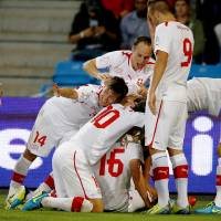 Photo - Switzerland's players celebrate after taking a 2-0 lead against Norway in their 2014 World Cup qualifying soccer match in Ullevaal stadium, Oslo, Sept. 10, 2013. (AP Photo/Scanpix Norway, Hakon Mosvold Larsen) NORWAY OUT