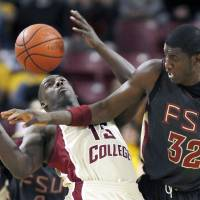Photo - Former Florida State center Solomon Alabi (right) has good size, a long wingspan and reach, and has a good basketball IQ. He's projected near where the Thunder has its first pick (No. 21). AP PHOTO
