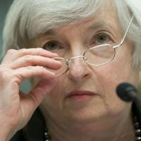 Photo - Federal Reserve Chair Janet Yellen removes her glasses as she testifies on Capitol Hill in Washington, Wednesday, July 16, 2014, before the House Financial Services Committee hearing entitled: