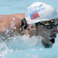 Photo - Michael Phelps warms up prior to competing in the 100-meter butterfly during the Arena Grand Prix, Thursday, April 24, 2014, in Mesa, Ariz. It is Phelps' first competitive event after a nearly two-year retirement. (AP Photo/Matt York)