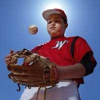 Photo - Washington freshman second baseman Chaz Orr on Tuesday, April 15, 2014 in Washington, Okla. Orr had open-heart surgery in the winter and has since earned a starting spot for the Warriors.   Photo by Steve Sisney, The Oklahoman