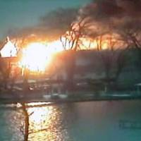 Photo - This image taken from video provided by WHAM13-TV, shows a wide view of homes on fire in an area where a gunman ambushed four volunteer firefighters responding to an intense pre-dawn house fire early Monday, Dec. 24, 2012, in Webster, N.Y., killing two before ending up dead himself, authorities said. Police used an armored vehicle to evacuate more than 30 nearby residents. (AP Photo/WHAM13-TV via AP video)