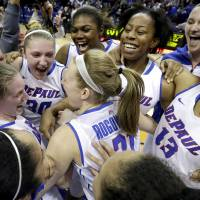 Photo - DePaul players celebrate after they defeated St. John's 65-57 during an NCAA college basketball game in the final of the 2014 Big East women's basketball tournament in Rosemont, Ill., Tuesday, March 11, 2014. (AP Photo/Nam Y. Huh)