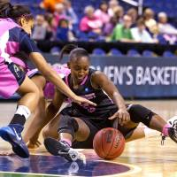 Photo - Wake Forest's Chelsea Douglas, right,  tries to control the loose ball between her legs as Pittsburgh's Brianna Kiesel reaches in during the 2014 ACC Women's Basketball Tournament at the Greensboro Coliseum, on Wednesday, March 5, 2014, in Greensboro, N.C. (AP Photo/News & Record, Joseph Rodriguez)