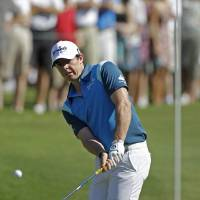 Photo -   Rory McIlroy, of Northern Ireland, watches his chip to the 14th green during the second round of the Players Championship golf tournament at TPC Sawgrass, Friday, May 11, 2012, in Ponte Vedra Beach, Fla. (AP Photo/Chris O'Meara)