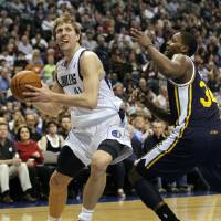 Photo -   Dallas Mavericks' Dirk Nowitzki, left, of Germany, drives against Utah Jazz's C.J. Miles (34) during the first half of an NBA basketball game, Saturday, March 3, 2012, in Dallas. (AP Photo/LM Otero)
