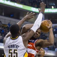 Photo -   Indiana Pacers center Roy Hibbert (55) puts a stop to the drive in the lane by Washington Wizards' power forward Trevor Booker during first-half action in an NBA basketball game in Indianapolis, Saturday, Nov. 10, 2012. (AP Photo/Doug McSchooler)