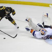 Photo - Buffalo Sabres' Ville Leino (23), of Finland, reacts after New York Islanders' Anders Nilsson (45), of Sweden, makes a save to preserve the win during a team shootout in an NHL hockey game in Buffalo, N.Y., Sunday, April 13, 2014.  The Islanders won 4-3. (AP Photo/Gary Wiepert)