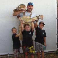 Photo - Team Bite Me's Justin Taylor at the 2011 Okie Noodling Tournament. PHOTO PROVIDED