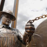 """Photo -  A closeup of one of the oilfield workers in Edmond's newest public art piece, """"West Edmond Oil Field,"""" in J.L. Mitch Park. PHOTO BY JIM BECKEL, THE OKLAHOMAN.   Jim Beckel -"""