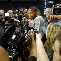 Photo -  Oklahoma City's Russell Westbrook answers a question after practice at FedExForum in Memphis, Tenn., Friday, April 25, 2014. The Oklahoma City Thunder will play the Memphis Grizzlies in Game 4 during the first round of NBA playoffs on Saturday, April 26, 2014. Photo by Bryan Terry, The Oklahoman