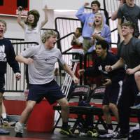 Photo - The Edmond North Huskies react as they win another match over the Muskogee Roughers at the class 5A and 6A Dual State wrestling finals at Claremore high school in Claremore, Okla., taken on February 9,2013. JAMES GIBBARD/Tulsa World