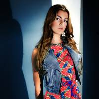 Photo - Averi wears a pleated print dress by Everly and denim vest by Mindcode, along with bangles and earrings, from Gil's Clothing.Photo by Chris Landsberger, The Oklahoman.  CHRIS LANDSBERGER