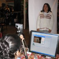 Photo - IDENTIFICATION CARD: A Mexican national living in Oklahoma gets her photo taken for a Mexican ID card Saturday morning at Chelino's restaurant in Oklahoma City. PHOTO BY JOHNNY JOHNSON, THE OKLAHOMAN ORG XMIT: 0810251954119921