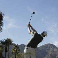 Photo - Brendon Todd watches his tee shot on the ninth hole during the third round of the Humana Challenge golf tournament at La Quinta Country Club on Saturday, Jan. 18, 2014 in La Quinta, Calif. (AP Photo/Chris Carlson)