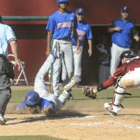 Photo - Florida's Richie Martin, third from left, takes advantage of a rundown between first and second and dives safely into home ahead of the throw to Alabama catcher Wade Wass, right, during an NCAA college baseball game on Sunday, May 4, 2014, in Tuscaloosa, Ala. (AP Photo/AL.com, Vasha Hunt) MAGAZINES OUT