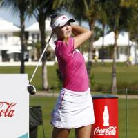 Photo - Jessica Korda of the U.S. drives on the 9th green during the last day of the LPGA Pure Silk Bahamas at the Classic Ocean Club Golf Course, in Paradise Island, Bahamas, Sunday, Jan. 26, 2014. (AP Photo/Dante Carrer)