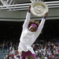 Photo - ADVANCE FOR WEEKEND EDITIONS, JUNE 22-23 - FILE - In this July 7, 2012 file photo, Serena Williams celebrates with the trophy after defeating Agnieszka Radwansk to win the women's final match at the All England Lawn Tennis Championships at Wimbledon, England. When Wimbledon starts Monday, June 24, 2013, she will be on a 31-match winning streak and an overwhelming favorite to win her second consecutive title.  (AP Photo/Kirsty Wigglesworth, File)