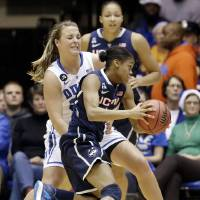 Photo - Connecticut's Moriah Jefferson is guarded by Duke's  Tricia Liston, rear, during the first half of an NCAA college basketball game in Durham, N.C., Tuesday, Dec. 17, 2013. (AP Photo/Gerry Broome)