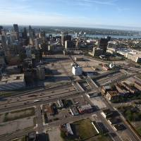 Photo - This photo taken Thursday June 14, 2012 shows an aerial view of downtown Detroit shows parking lots behind The Fox Theatre and the State Theatre. Detroit Red Wings and Fox Theatre owner Mike Ilitch said Tuesday, Dec. 4, 2012, that he plans a $650 million multiuse development in the area that will include a new venue for the NHL club. (AP Photo/Romain Blanquart, Detroit Free Press)