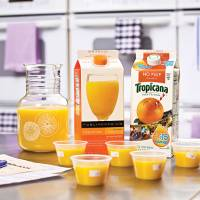 Photo - Different types of orange juice are shown in a test kitchen. The price of orange juice is decreasing.  Photo provided