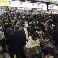 Photo - People crowd at Sendai railway station in Sendai, Miyagi Prefecture, Friday, Dec. 7, 2012 after trains were halted following a strong earthquake struck off the coast of northeastern Japan. It is the same region that was hit by a massive earthquake and tsunami last year. (AP Photo/Kyodo News) JAPAN OUT, MANDATORY CREDIT, NO LICENSING IN CHINA, FRANCE, HONG KONG, JAPAN AND SOUTH KOREA