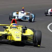 Photo - Jacques Villeneuve, of Canada, drives through the first turn during the Indianapolis 500 IndyCar auto race at the Indianapolis Motor Speedway in Indianapolis, Sunday, May 25, 2014. (AP Photo/Tom Strattman)