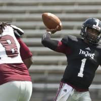 Photo - Troy's quarterback Dontreal Pruitt (1) drops back to pass the ball during an NCAA college football scrimmage on Saturday, Aug. 9, 2014, in Troy, Ala. (AP Photo/Brynn Anderson)