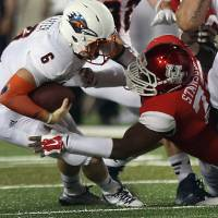 Photo - UTSA quarterback Tucker Carter (6) is sacked by Houston defensive end Gavin Stansbury (72) during the second quarter of an NCAA college football game Friday, Aug. 29, 2014, in Houston. (AP Photo/Houston Chronicle, Brett Coomer) MANDATORY CREDIT