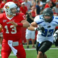 Photo -   Illinois State quarterback Matt Brown (13) is chased by Eastern Illinois' Pat Wertz (93) during the first half of an NCAA college football game at Hancock Stadium in Normal, Ill., Saturday Sept. 15, 2012. Wertz caused Brown to fumble the ball that was recovered by Illinois State's Pete Cary. (AP Photo/The Pantagraph, Steve Smedley)