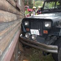 Photo - This photo provided by the Myrtle Creek Police Department shows a Jeep that authorities say a toddler crashed into an home in Myrtle Creek, Ore. The 3-year-old boy wearing only a diaper climbed into the Jeep on Tuesday, July 24, 2014, and knocked it out of gear, according to authorities. Witnesses said it rolled down the street, through an intersection and into the house, causing minor damage. After the crash authorities said the toddler ran back to his home to watch cartoons. (AP Photo/Myrtle Creek Police Department)