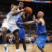 Photo - Oklahoma City's Serge Ibaka (9) tries to get the ball past Dallas' Jason Kidd (2) during the NBA basketball game between the Oklahoma City Thunder and the Dallas Mavericks at Chesapeake Energy Arena in Oklahoma City, Monday, March 5, 2012. Photo by Nate Billings, The Oklahoman
