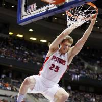 Photo - Detroit Pistons forward Kyle Singler (25) dunks against the Boston Celtics in the first half of an NBA basketball game, Sunday, Jan. 20, 2013, in Auburn Hills, Mich. (AP Photo/Duane Burleson)