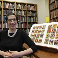 Photo - Assistant curator Freyda Spira, of the department of drawings and prints, poses with football cards, Wednesday, Jan. 8, 2014, part of an exhibition to be mounted at the Metropolitan Museum of Art in New York. The museum better known for high art, is presenting a pop-up exhibition celebrating football's history through the ages with vintage trading cards. The 150 cards, including a series from 1894, are part of approximately 600 football cards from the museum's vast collection of sport trade cards donated to the Met by the late hobby pioneer Jefferson Burdick. The exhibit opens Jan. 24 and runs through Feb. 10. (AP Photo/Kathy Willens)