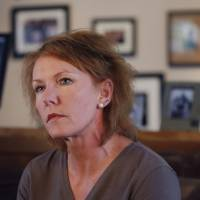 Photo - Melinda Coleman listens to a question during an interview in her home in Albany, Mo., Wednesday, Oct. 16, 2013. Coleman says justice was denied when charges were dropped against the boys that her 14-year-old daughter said sexually assaulted her and a 13-year-old friend. (AP Photo/Orlin Wagner)
