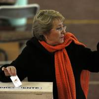 Photo - Former President Michelle Bachelet casts her vote during presidential primaries in Santiago,  Chile, Sunday June 30, 2013. Voters will pick a candidate from Chile's two grand coalitions, the New Majority on the left and the conservative Alliance for Chile on the right. The vote will decide who runs in the Nov. 17 presidential election. Bachelet is likely to win the New Majority slot. (AP Photo/Luis Hidalgo)