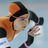 Photo - Ireen Wust of the Netherlands, her nails painted in the colors of the Dutch flag, competes in the women's 3,000-meter speedskating race at the Adler Arena Skating Center during the 2014 Winter Olympics, Sunday, Feb. 9, 2014, in Sochi, Russia. (AP Photo/Matt Dunham)